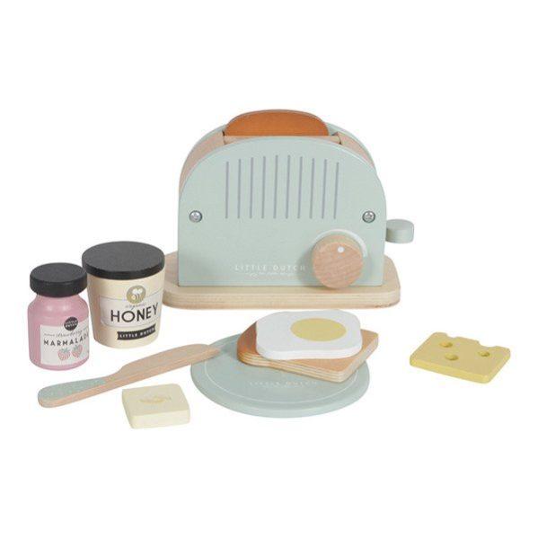 Drewniany toster marki Little Dutch to wiele możliwości fantastycznej zabawy zarówno dla dziewczynek, jak i dla chłopców. W zestawie oprócz tostera znajdziemy również dwa tosty, miodek, dżem, plasterek serka, masełko, jajeczko oraz talerzyk. Toster będzie się świetnie komponował z kuchnią Little Dutch oraz Ekspresem do kawy.